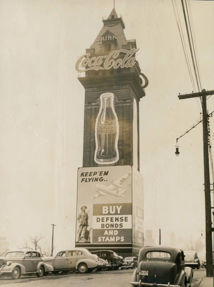 Minneapolis Has World's Tallest Sign (1941)  View of the Coca-Cola sign on the tower of the old Exposition Building, which stands 225 feet high. The sign marks the site of the Coca-Cola Bottling Company's new plant on Central Avenue, on the east bank...
