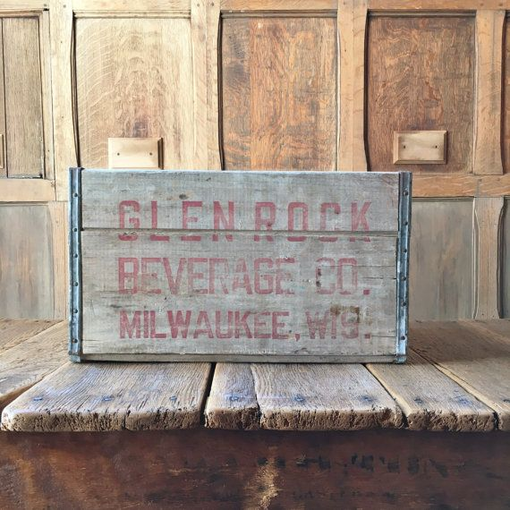 VINTAGE WOOD CRATE, GLEN ROCK BEVERAGES CO WOODEN CRATE, MILWAUKEE WISCONSIN WOOD SODA CRATE, VINYL RECORD STORAGE  Fabulous 1960s Glen Rock Beverages wood soda crate. Sturdy, thick wood walls. Useful and displays great. Naturally weathered gray. Deep red script on three sides. Glen Rock Beverage Co. Milwaukee, Wis. on two sides, Deposit $2.00 on one short end. Good vintage condition overall. Normal wear from use. Scuffs, scratches, dings, dents, nail holes, small splits in wood, minor…