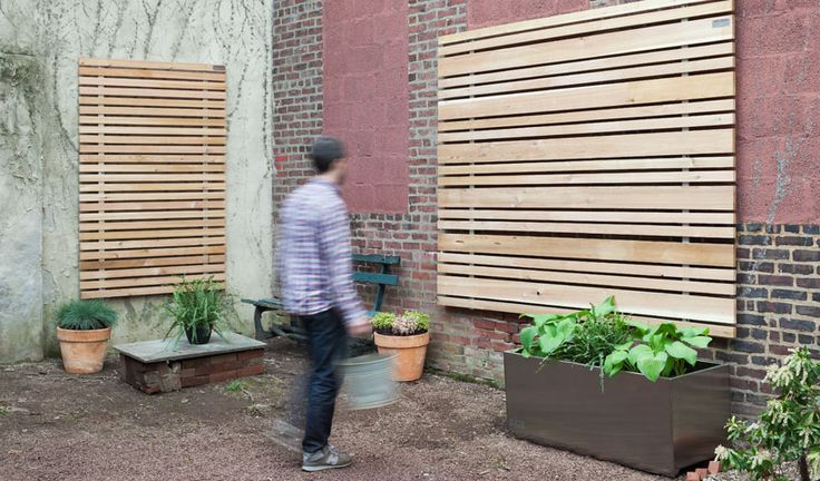 Attaching Plants To The Wood Slat Wall For The Home