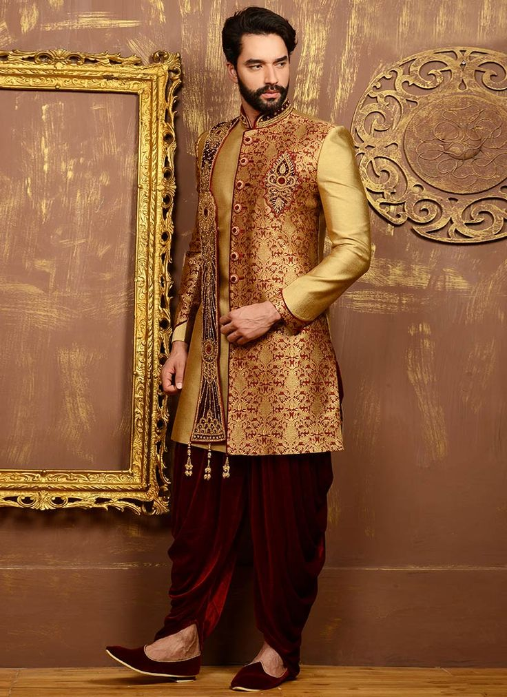 Buy Golden N Maroon Dhoti Style Achkan Sherwani online from the wide collection of achkan-sherwani.  This Maroon | Gold colored achkan-sherwani in Art Silk fabric goes well with any occasion. Shop online Designer achkan-sherwani from cbazaar at the lowest price.