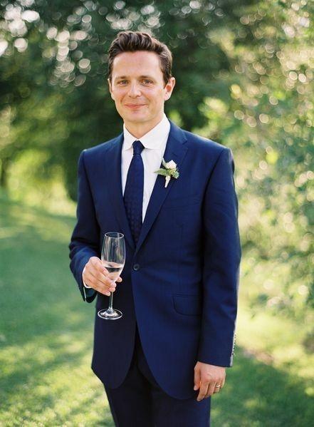 Handsome Groom in Blue Suit.