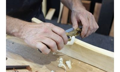 Curved sole spokeshave in use