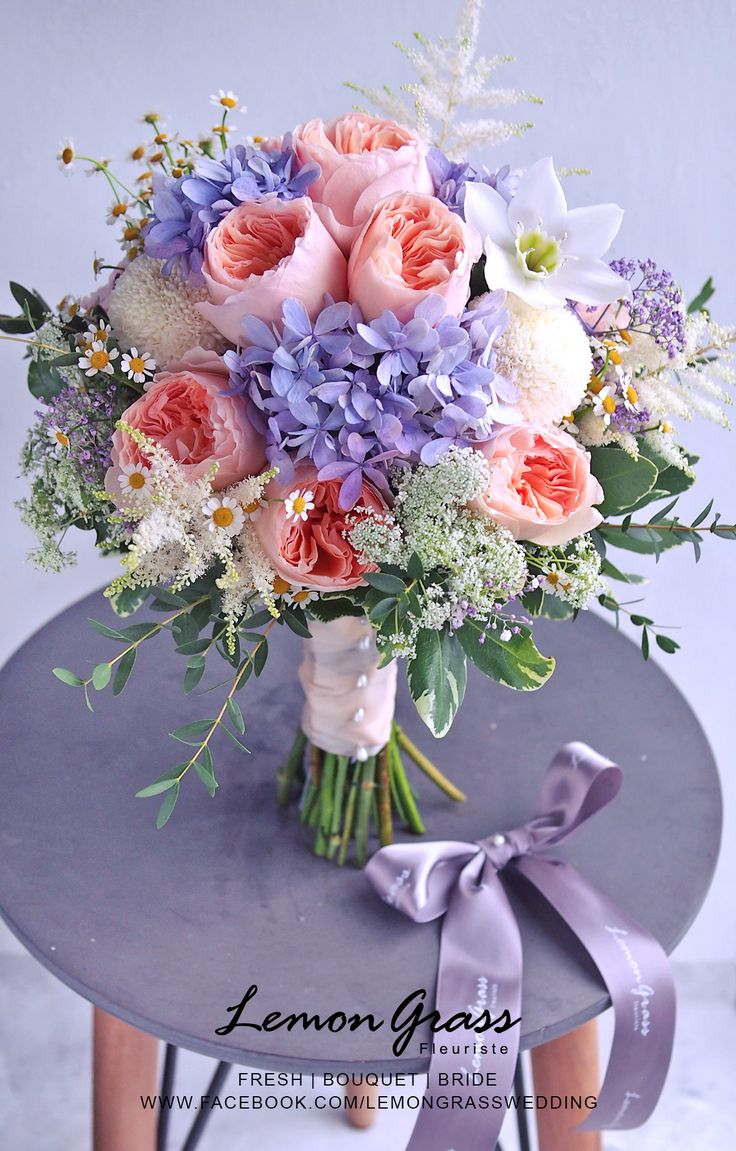 Round hand tied bouquet with Pink peonies, white heather and hellebore, feverfew or mini daisy pom, queen anne's lace, blue hydrangea, variegated pitt, eucalyptus. Tier 3