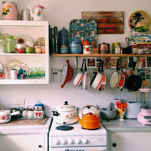 This is probably what my kitchen in Japan will look like....but also with a magnetic knife holder on the wall as well. Those pots are ADORABLE and I bet Japan has them! :D