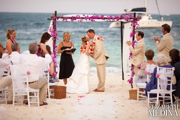 Love the flower petals on the sand...BUT LESS pink on the arch...more white i think