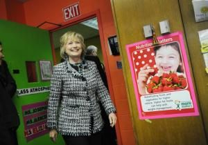 Hillary Clinton trumpeted the importance of early-childhood education in a visit to East Harlem on Tuesday and urged parents to sing and read to their kids.
