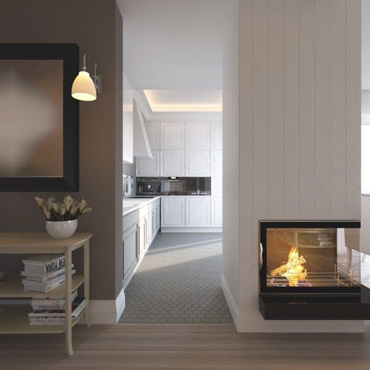 Wystrój wnętrz rezydencji pod Warszawą. Eleganckie, jasne wnętrze kuchni łączą elementy klasyki i nowoczesności. Narożny kominek domyka całą przestrzeń.