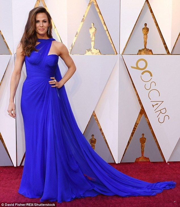 Star power: Jennifer Garner went for old time glamour as she arrived for the Academy Awards in Hollywood on Sunday wearing a cobalt blue sleeveless gown with long train