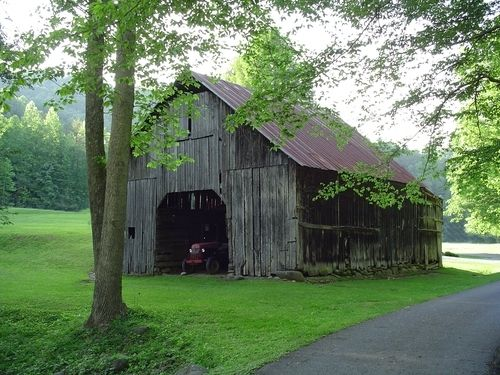 old barn amidst bright green grass in Sevierville, TN