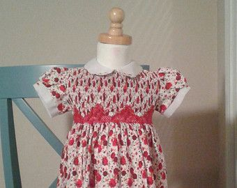 On Sale Regurar 35 now 25 Baby girl Christmas Dress, READY TO SHIP, Holiday outfit, Christmas outfit. Smocked Holiday Dress READY TO SHIP PRIORITY MAIL  READY TO BE SHIPPED, PRIORITY MAIL This red baby Christmas girl dress in cotton fabric, hand Smocked, buttons in the back for an easy on and off. Our dresses are hand smocked by skilled artisans. Your purchase not only helps them to support their families, but also furthers the tradition of passing their knowledge on to the next generation…