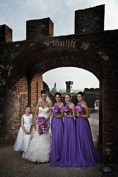 My girls - love them!  Bridesmaid dresses from: www.facebook.com/showstoppers123  Venue: La Rocca Visconteo Veneta, Lake Garda, Italy