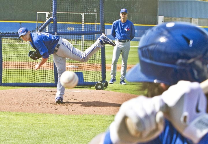 Brett Cecil pitches to Colby Rasmus, Spring Training, 2012. Super-awesome photo skills by John Lott (of the National Post)