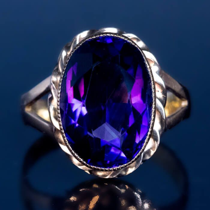 made in Moscow between 1899 and 1908 A 14K rose gold ring features a bezel-set oval Siberian amethyst of a deep royal purple color. The amethyst measures 1
