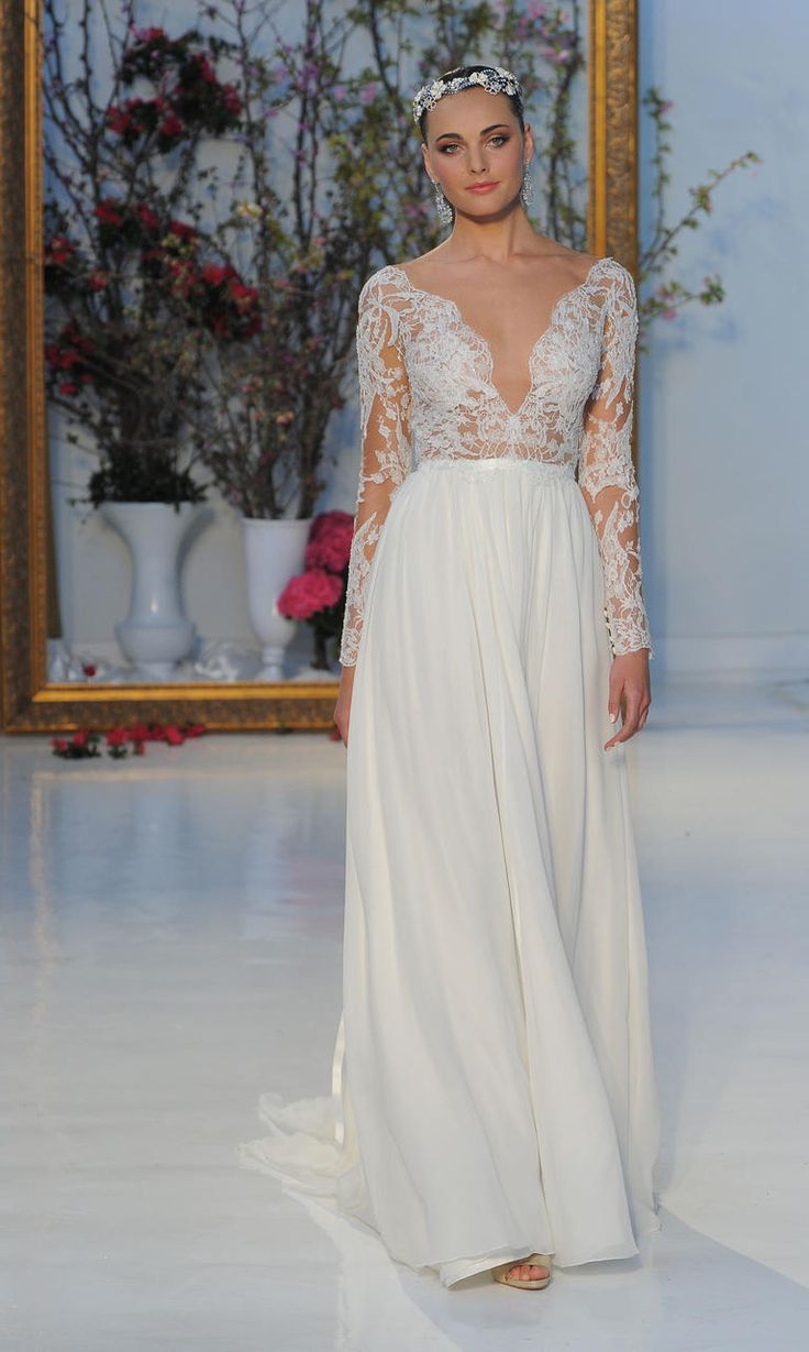 Long sleeves with plunging neckline and lace details | Anne Barge Spring 2017 | https://www.theknot.com/content/anne-barge-wedding-dresses-bridal-fashion-week-spring-2017