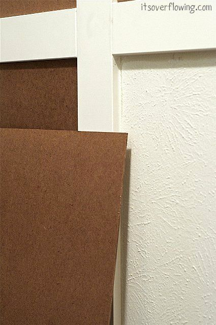 Using 1/8 inch furniture backing board for covering up wall texture on Board and Batten Wall