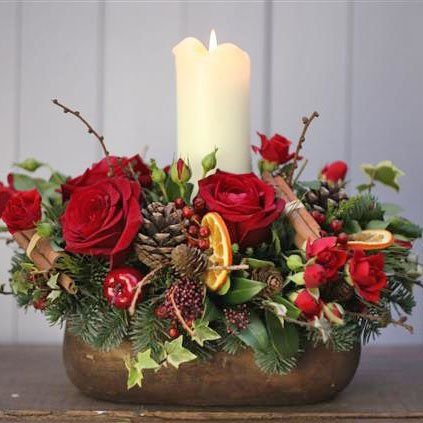 Margaret Emms Christmas Long and Low Table Centre - Red - Margaret Emms Fresh Flowers Delivered A festive arrangement filled with red seasonal flowers, festive foliages, aromatic decorations and a chunky church candle. The table centre is seated in a rustic ceramic pot.<br /><br />l http://www.comparestoreprices.co.uk/december-2016-3/margaret-emms-christmas-long-and-low-table-centre--red--margaret-emms-fresh-flowers-delivered.asp