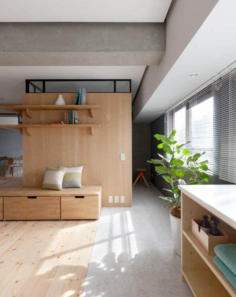 Tokyo architecture studio Sinato added a L-shaped wall into the centre of this apartment in Japan to partition off space for two new bedrooms