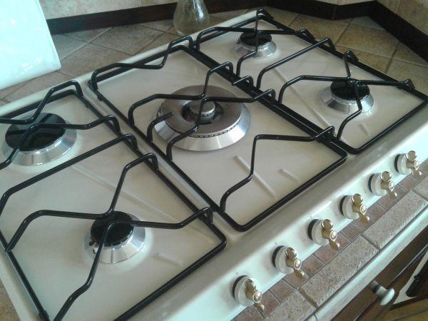 pulire piano cottura