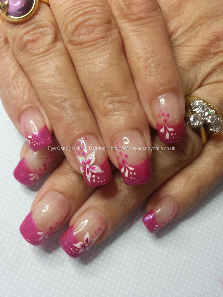 Pink tips with freehand flower nail art on acrylic nails