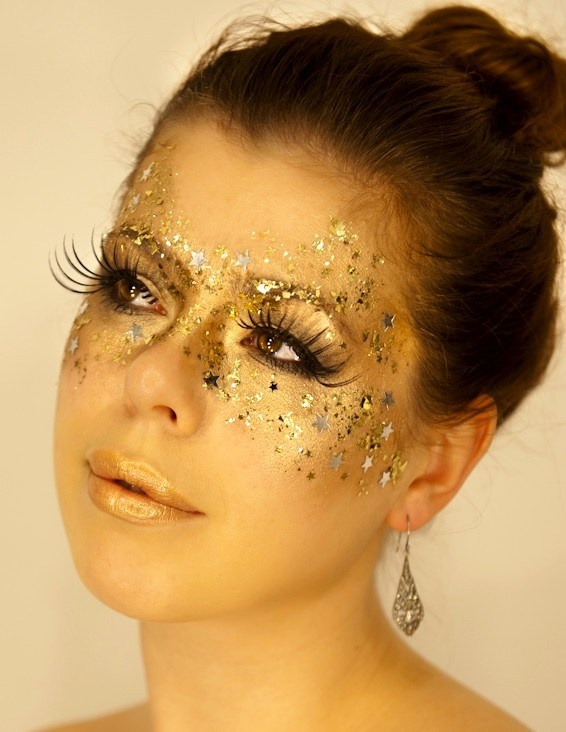 Gold mask eye make-up with false lashes inspiration for New Years Eve.