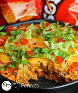 Layered Doritos Casserole is a ground beef casserole recipe with sour cream, salsa, onion, cheese, and more!