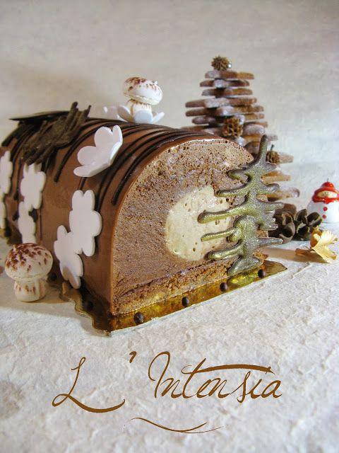 Bûche L' Intensia (Dacquoise amandes/noisettes, croustillant feuilletine, crémeux praliné, mousse au chocolat noir, glaçage au praliné)