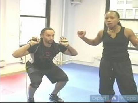How To Exercise With Resistance Bands : Squat Exercises With Resistance Bands    I'm Carlos...but my guy makes me extend my arms when I stand up.