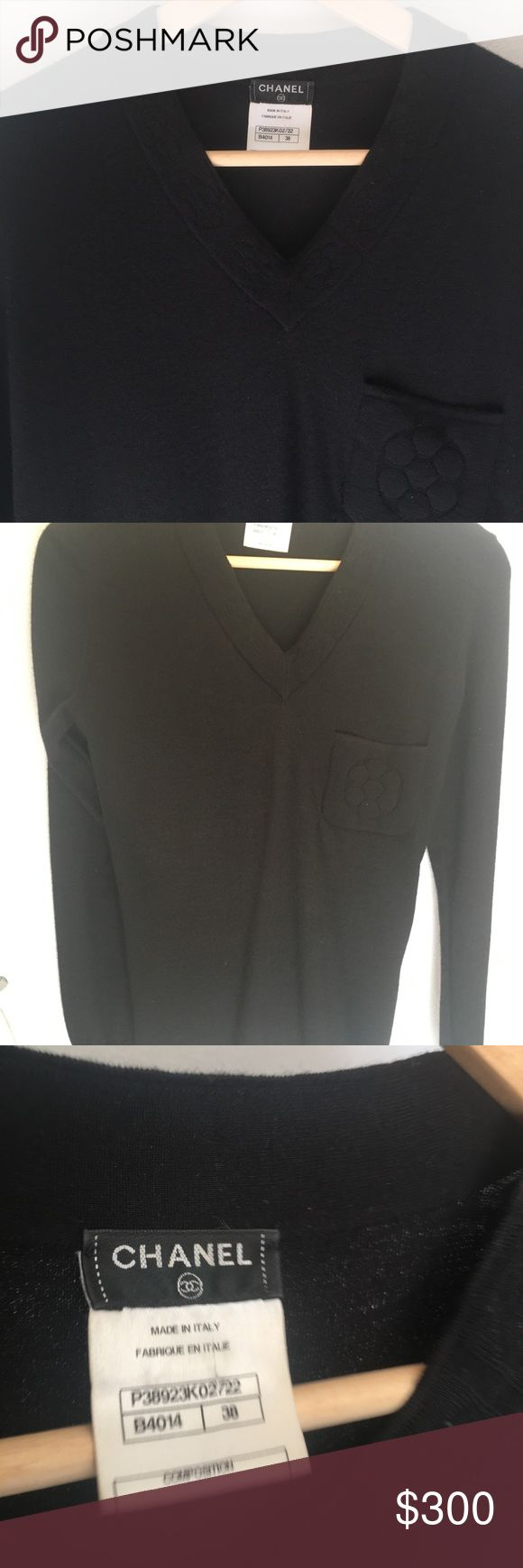 Chanel Black Sweater Camilla Long sleeve Authentic guaranteed. Chanel Camilla black sweater. Cashmere. Camellia pocket detail. Gold trim. Amazing top! Size 38. Small. Good used condition. CHANEL Sweaters V-Necks