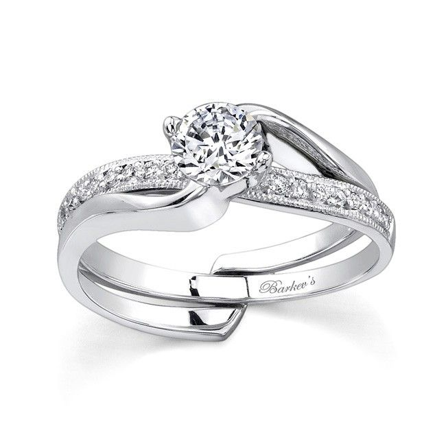 This Interlocking Diamond Wedding Set Features Pave Diamonds The Solitaire Engagement Ring Sports A Prong Center Held In Grasp Of