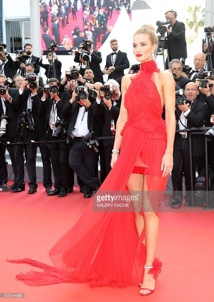 British model Rosie Huntington-Whiteley poses as she arrives on May 18, 2016 for the screening of the film 'The Unknown Girl (La Fille Inconnue)' at the 69th Cannes Film Festival in Cannes, southern France. / AFP / Valery HACHE