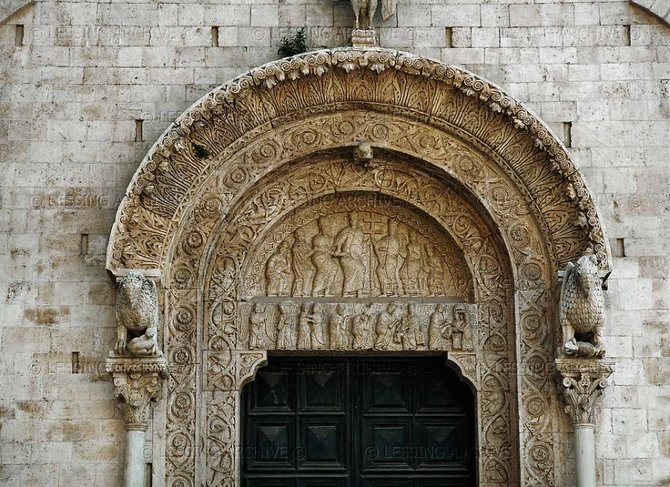 ROMANESQUE ARCHITECTURE 12TH CENTURY   Portal of the cathedral of Bitonto with rich stone- carvings and two lions supporting the arc.   Cathedral, Bitonto, Italy