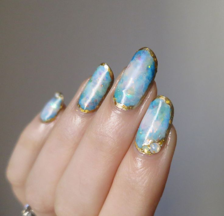 http://magick-dragon.tumblr.com/post/136750825381/ladycrappo-some-more-opal-nails-inspired-by 1/2