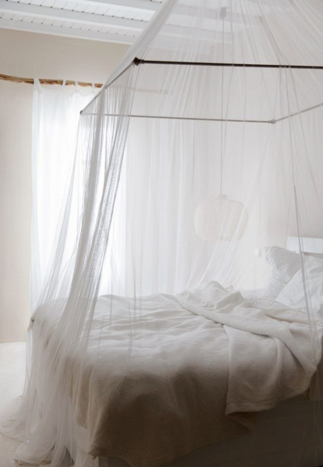 White Bedroom With Mosquito Net