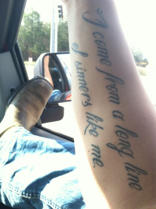I don't want this tattoo... Just too hot to pass up!  probably the most attractive thing ive ever seen in my life. even without a face. eric church tattoo and boots in a truck