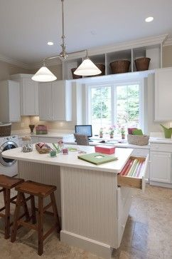 I love that this is a craft room and laundry room. Totally multipurpose! Get laundry done and craft at the same time.