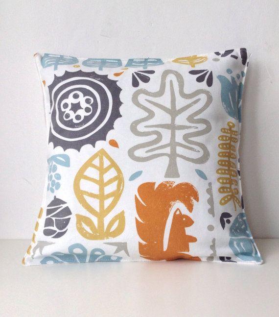 Woodland cushion cover squirrel pine cone orange powder blue grey on Etsy, $23.53