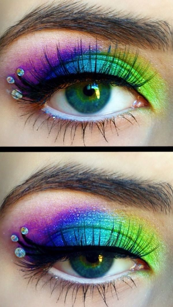 A spectrum of vivid eye shadow colors accented by a trio of crystals.