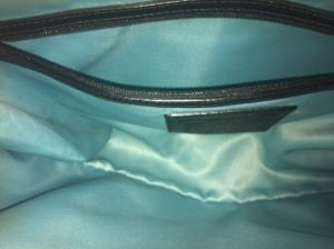 Clean Satin lining of your name brand purse!