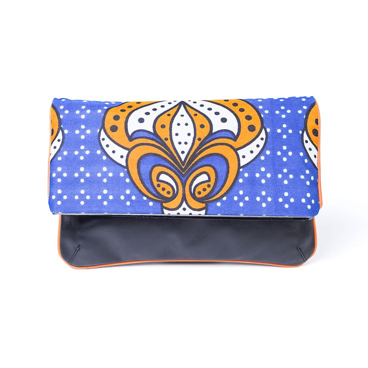 YOU KHANGA Blue Clutch is made of blue and black (inside) etnic fabric khanga and nappa leather. it's the perfect size to hold your cards, cell and lipstick - attach the strap to carry it over your shoulder.  Buy it now at http://finaest.com/designers/you-khanga/youkhanga-blue-clutch