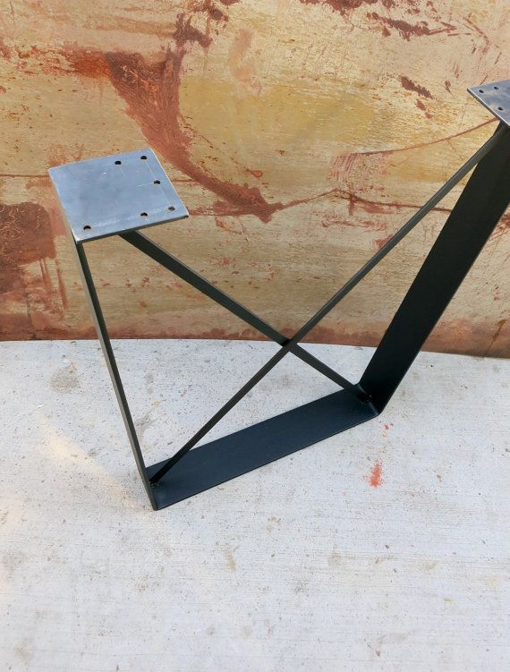 This contemporary table leg design is simply rustic. They are in the shape of a trapezoid and the bottom width is about 6 inches smaller than the
