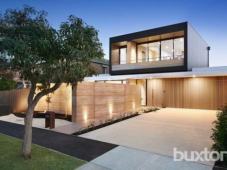 40 Camperdown Street, Brighton East- Ian Perkins Design & Grab Property Group.The linear timber façade, hand crafted rammed-earth feature walls and deck-style runway create an organic yet luxurious aesthetic that effortlessly blurs the lines between inside and out. A sparkling, white tiled pool and spectacular central courtyard