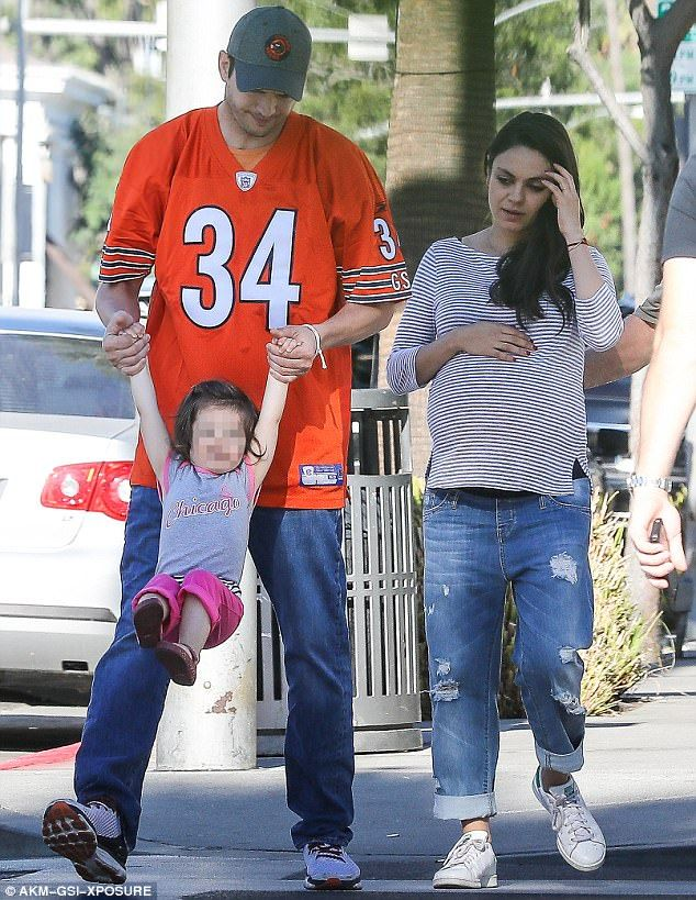 Daddy fool: Ashton, here with wife Mila Kunis and daughter Wyatt, was left red-faced when he got the age of his four-month-old son Dimitri wrong