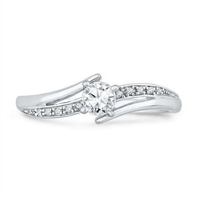 Don't trust the link. The one in this picture has the full 1 diamond, the link is cheap. Damn amazon moving their stuff around  http://www.amazon.com/White-Round-Diamond-Bypass-Promise/dp/B004LWD1FO/ref=sr_1_99?s=jewelry=UTF8=1374115278=1-99 149