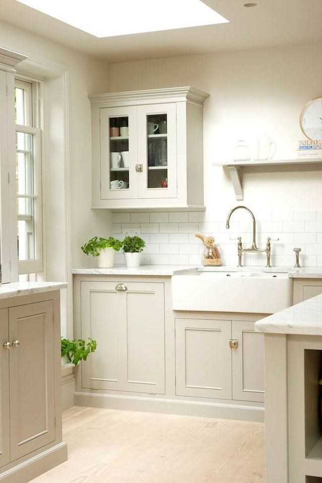 I love this simple classic bespoke kitchen design by deVOL Kitchens. The muted tones, Carrara marble worktops, subway tiles, classic cabinets, copper pendant lights & butler sink … all perfect! x debr