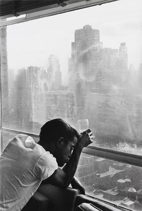 NYC. Sammy Davis Jr. looks out a Manhattan window, 1959.    By Burt Glinn