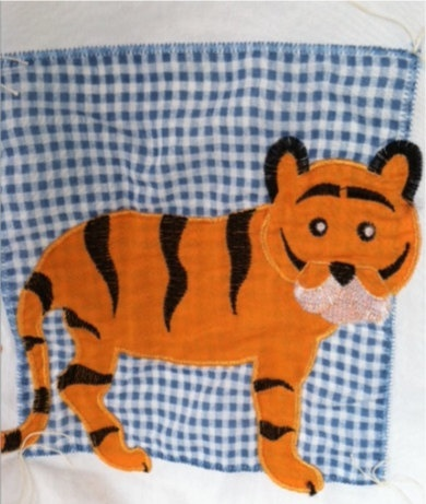 A large animal handmade baby quilt by LincolnsGranny on Etsy, $49.95