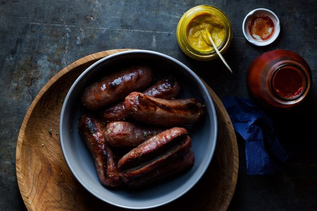 Roasted sausages with mustard and ketchup