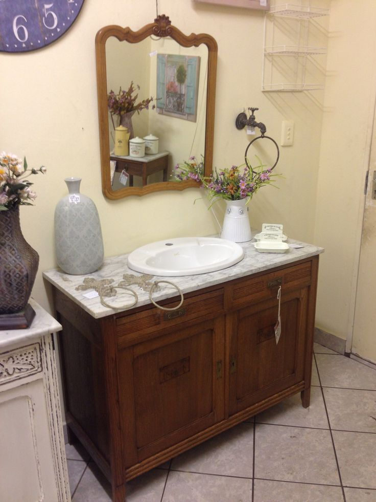 Single vanity with original Carrara marble top