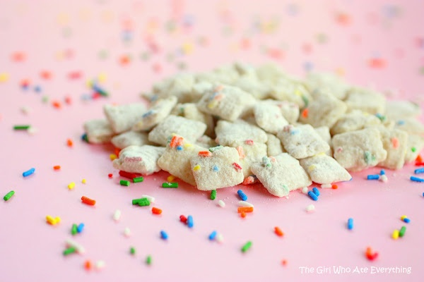 """[recipe] Cake Batter Muddy Buddies: """"You could use any flavor of cake mix, but I think yellow has the strongest cake batter flavor. That may all be in my head, but that's my theory and I'm sticking to it.  Once you add the cake mix to the almond bark covered Chex mix, put it in a covered container or a large bag and shake it like a Polaroid picture."""""""
