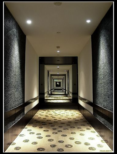 Corridor hotel hallway lighting architecture. I love walking down broad, carpeted hotel corridors.